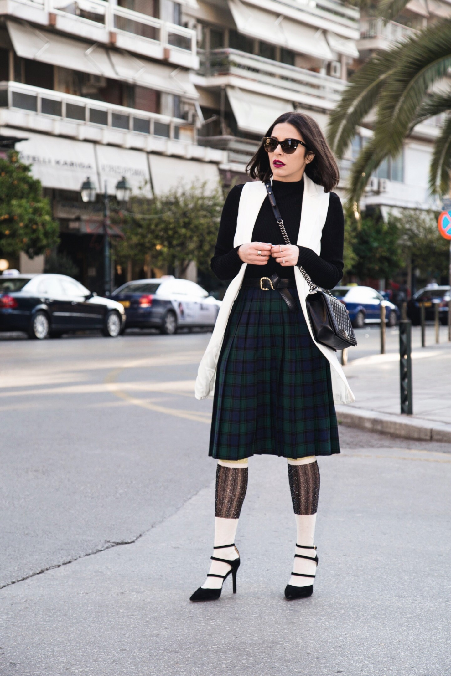 back to school look with a pleated tartan skirt