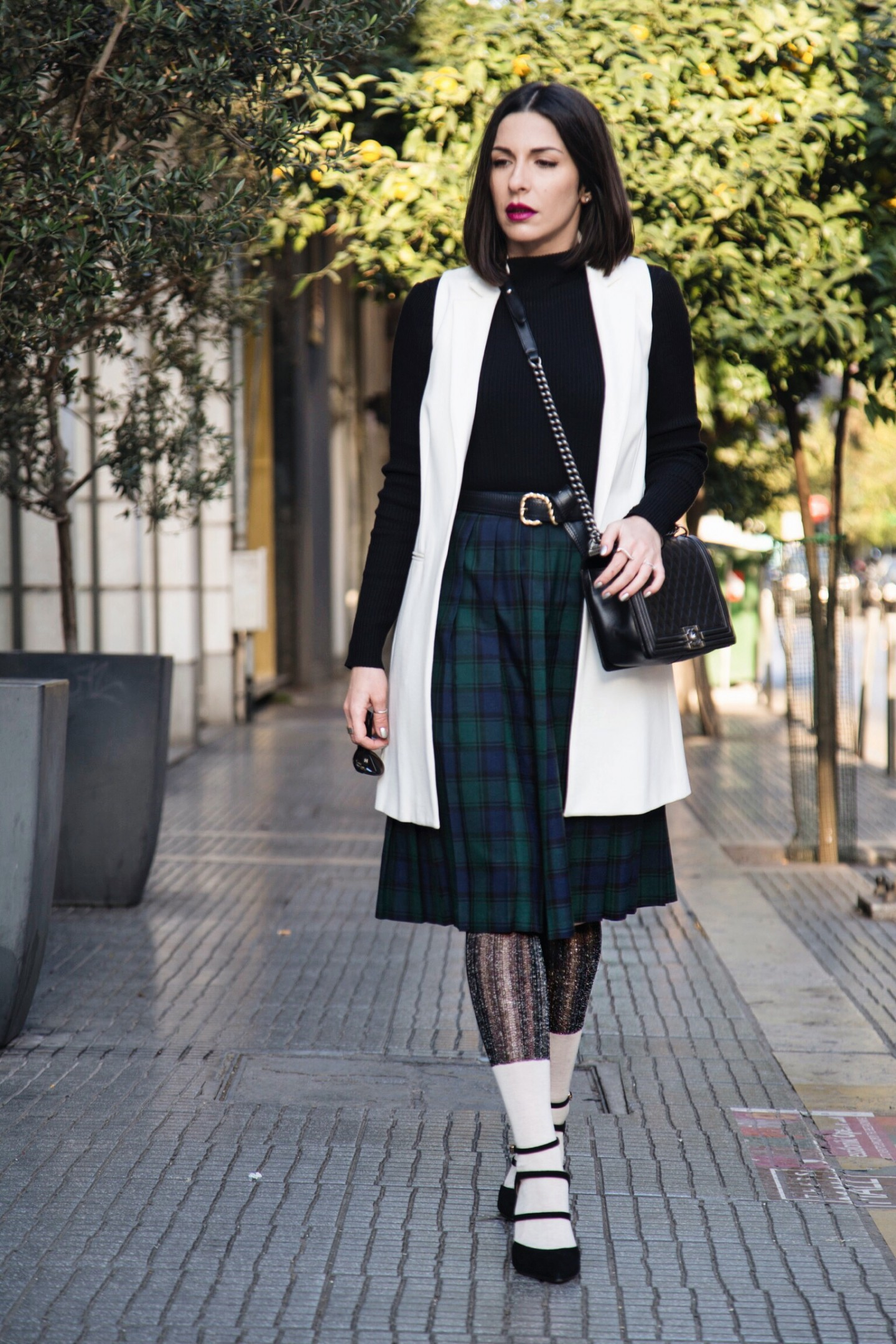 schoolgirl look with pleated tartan skirt