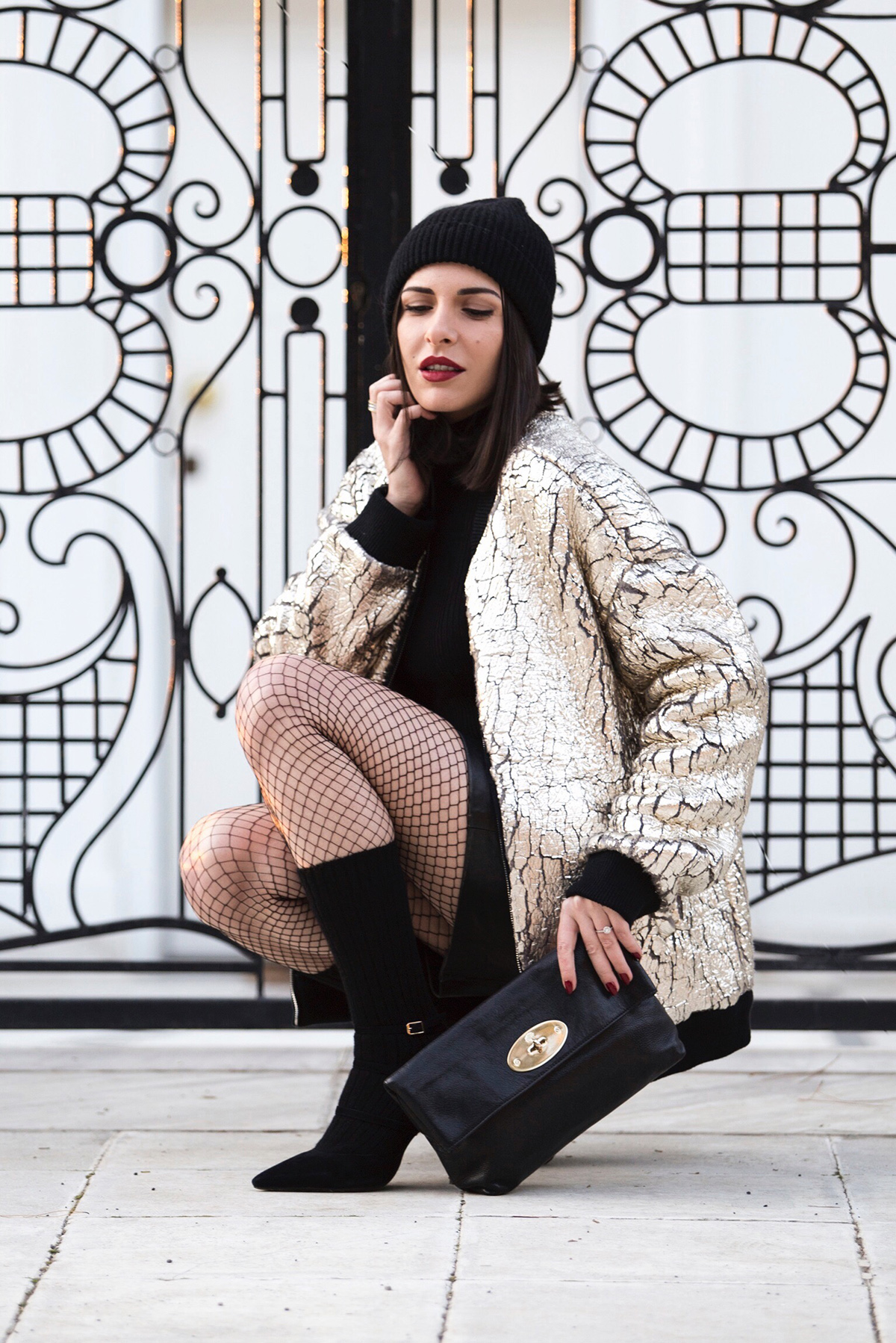 holiday outfit idea: gold bomber jacket