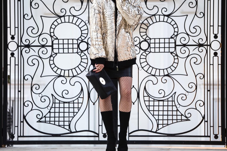 gold bomber jacket and skirt