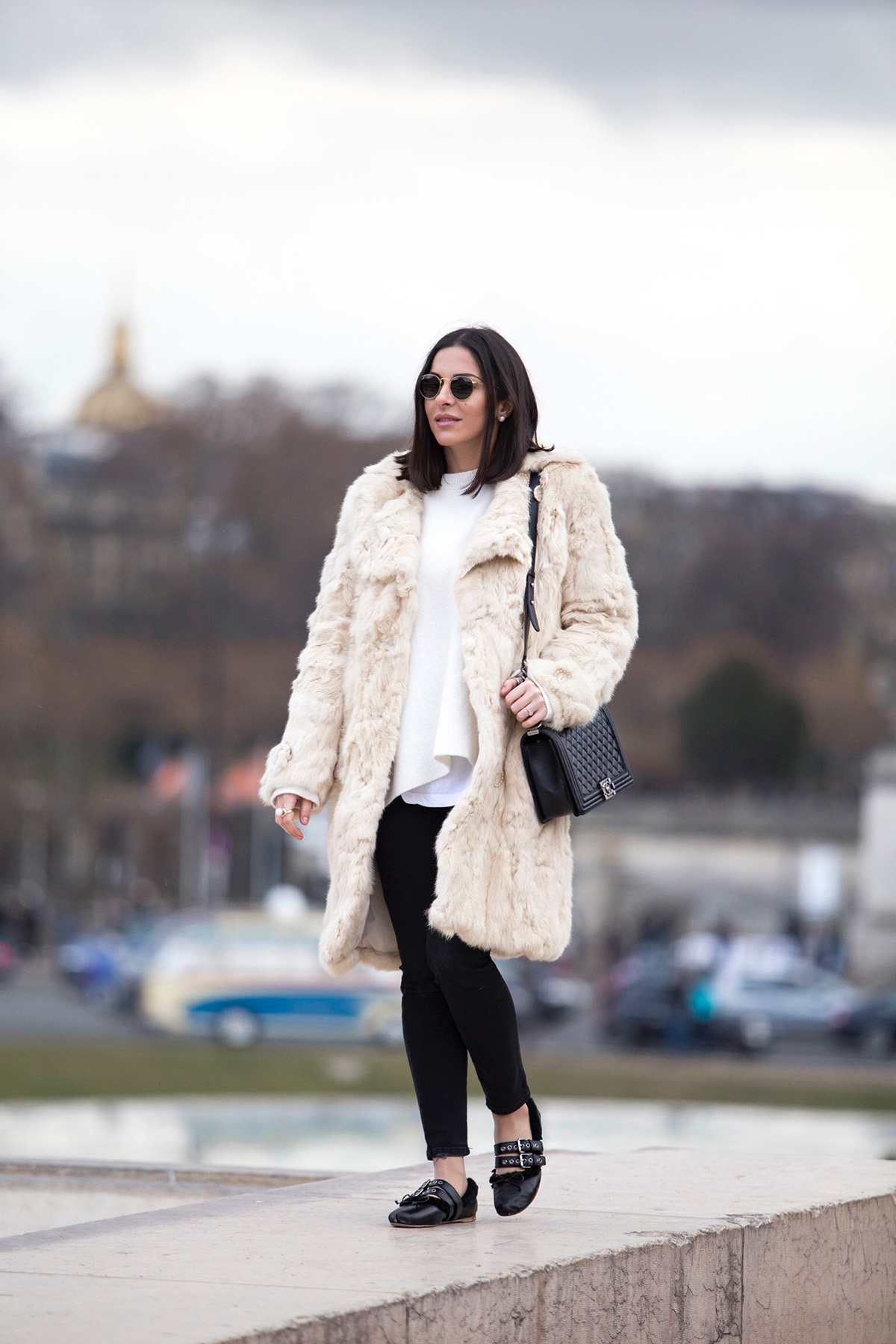 Stella Asteria, Fashion & Lifestyle blogger wearing white fur coat and Chanel boy bag