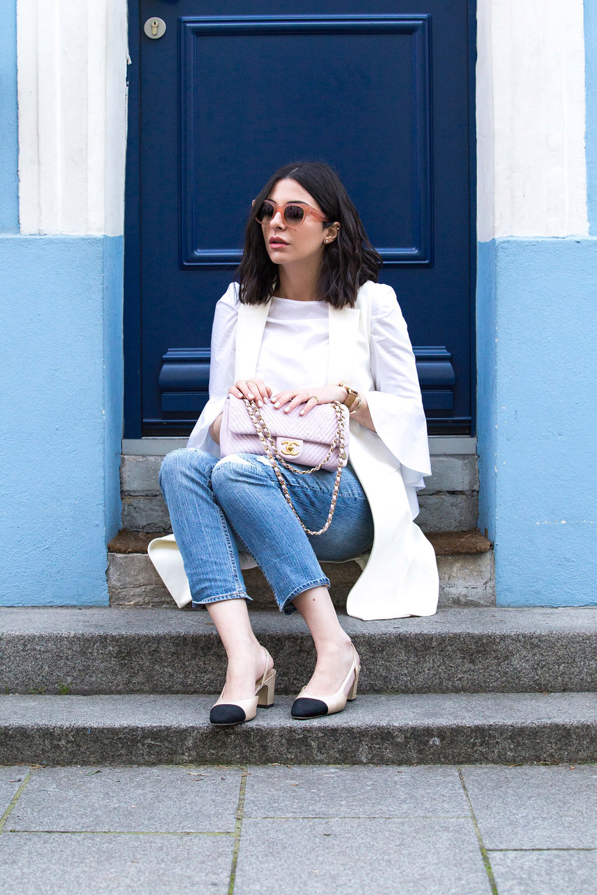 Stella Asteria wearing jeans and Chanel slingbacks, Chanel pink leather chevron bag