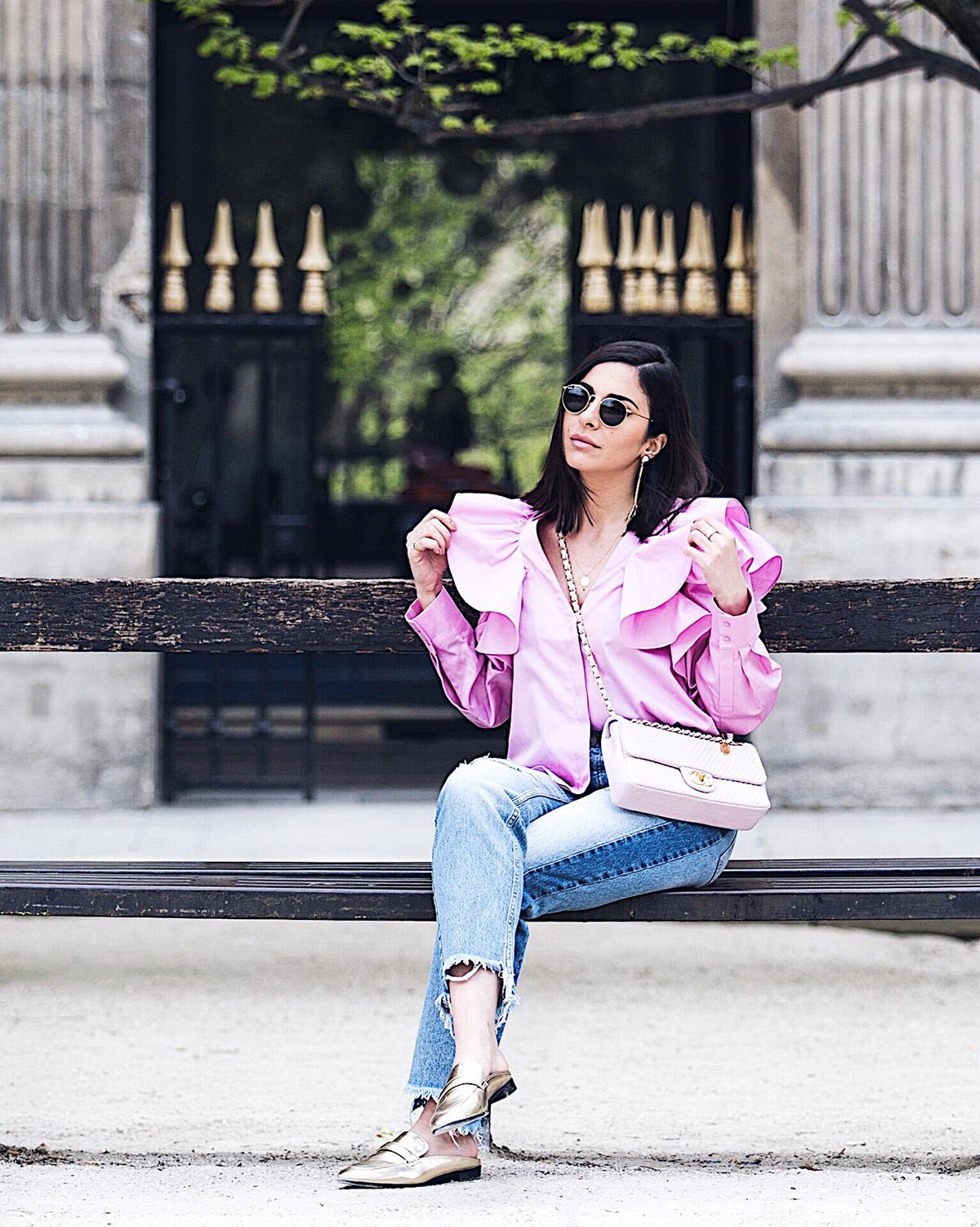 Stella Asteria wearing pink ruffle blouse