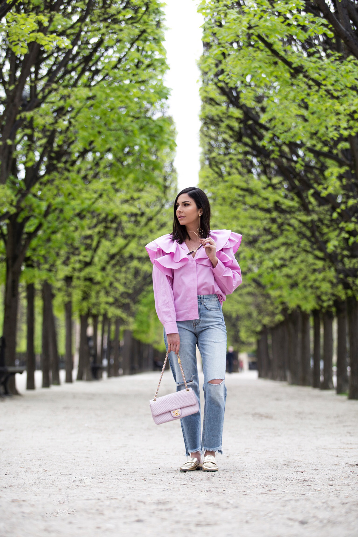 Stella Asteria Fashion & Lifestyle Blogger wearing pink ruffle blouse, jeans and pink Chanel bag