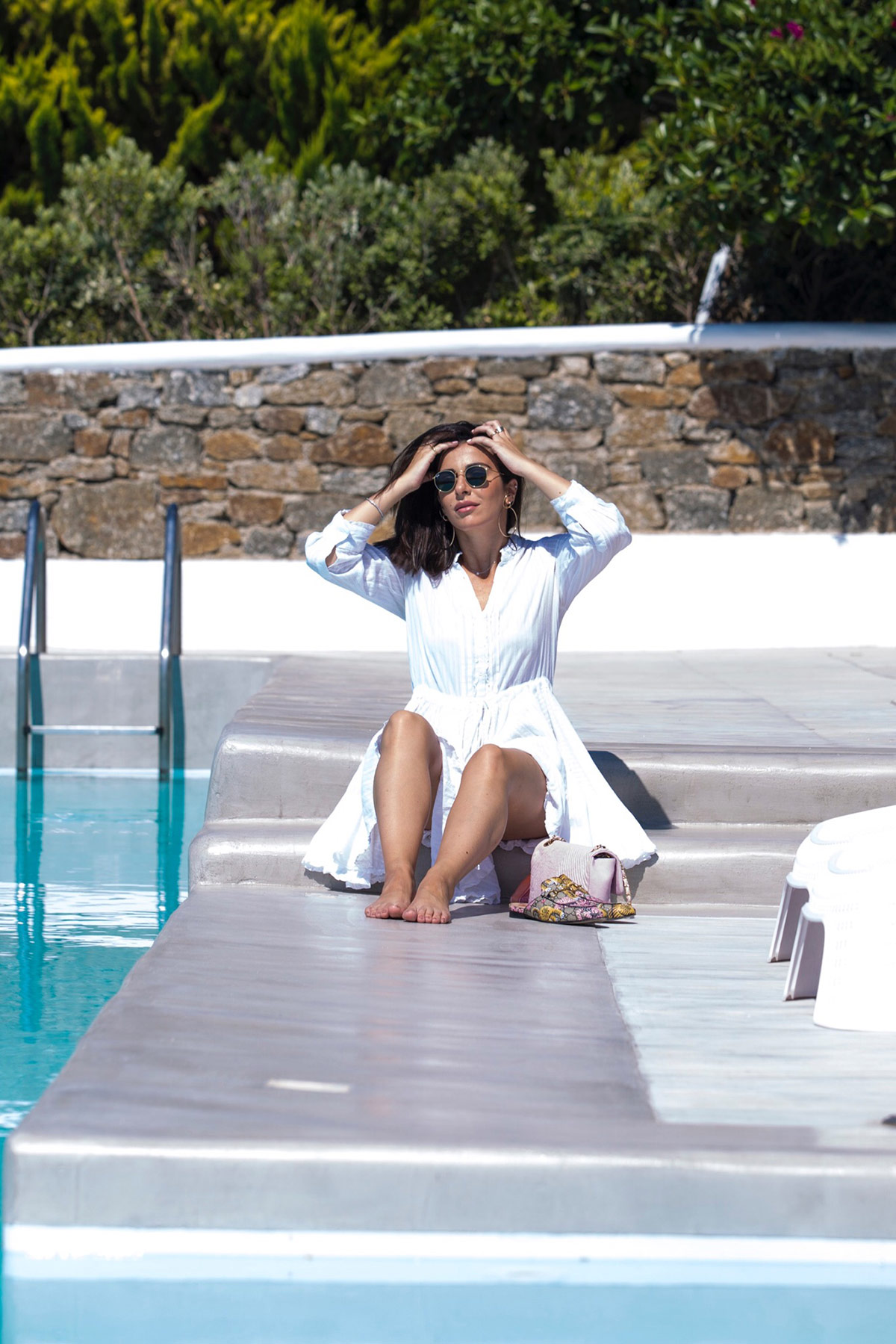 Stella Asteria Fashion & Lifestyle Blogger wearing a little white dress in Mykonos