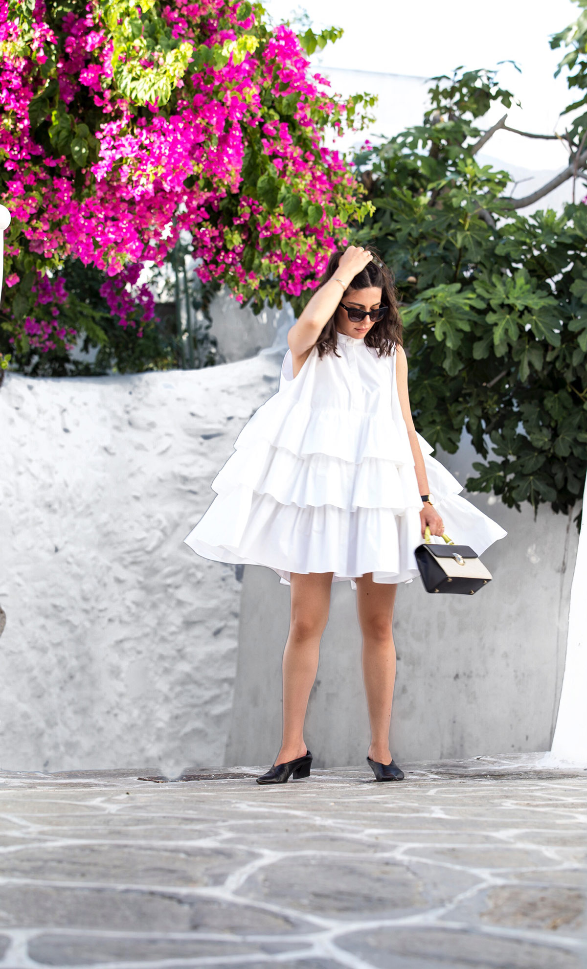Stella Asteria wearing a little white frilled dress in Mykonos