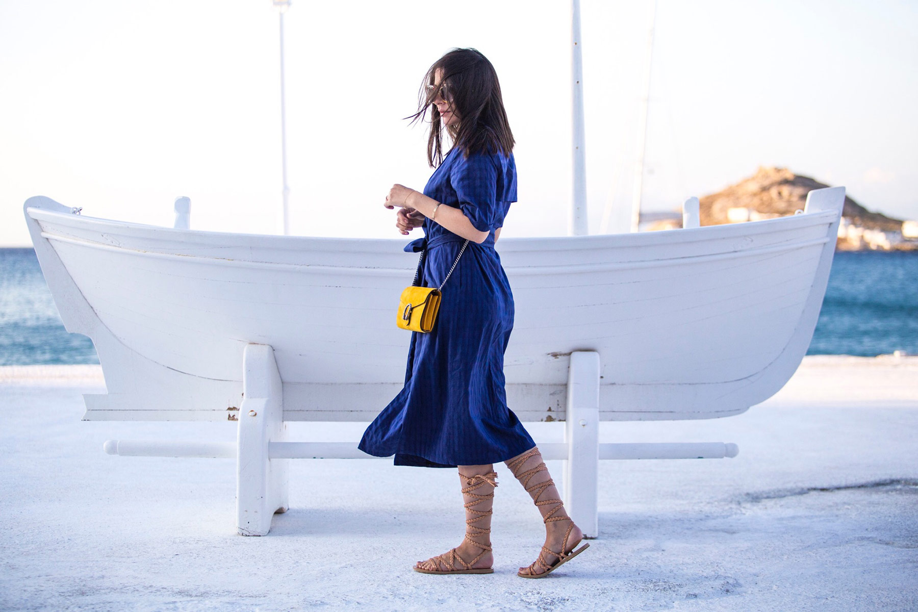 a3235e0e4ed2 Stella Asteria wearing blue dress   yellow Gucci Dionysus bag in Mykonos ...