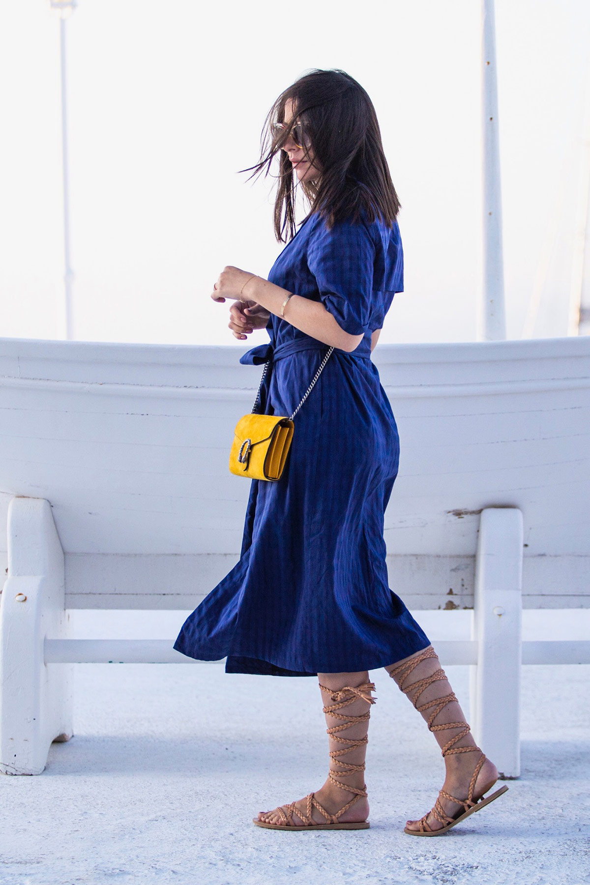 Stella Asteria wearing blue dress & yellow Gucci Dionysus bag in Mykonos