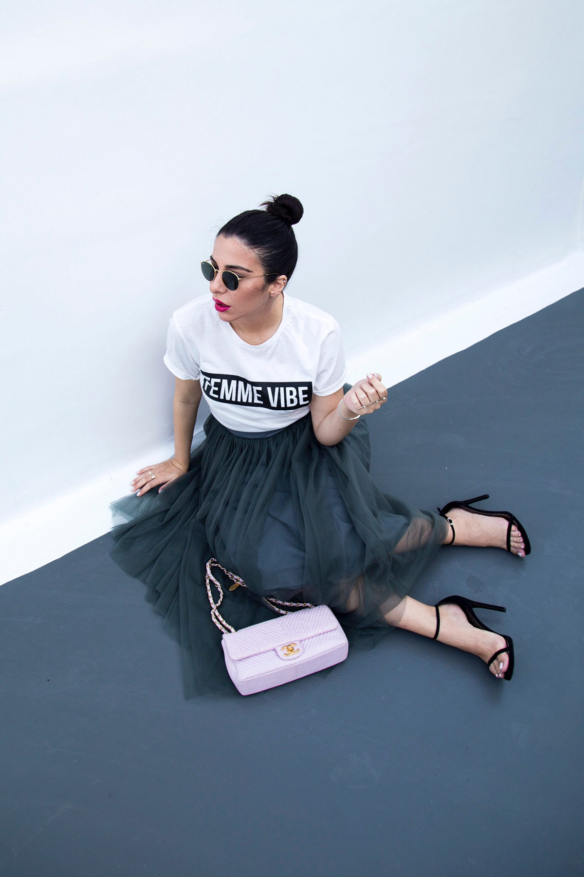 Stella Asteria wearing tulle skirt with logo top, Stuart Weitzman sandals & pink Chanel bag