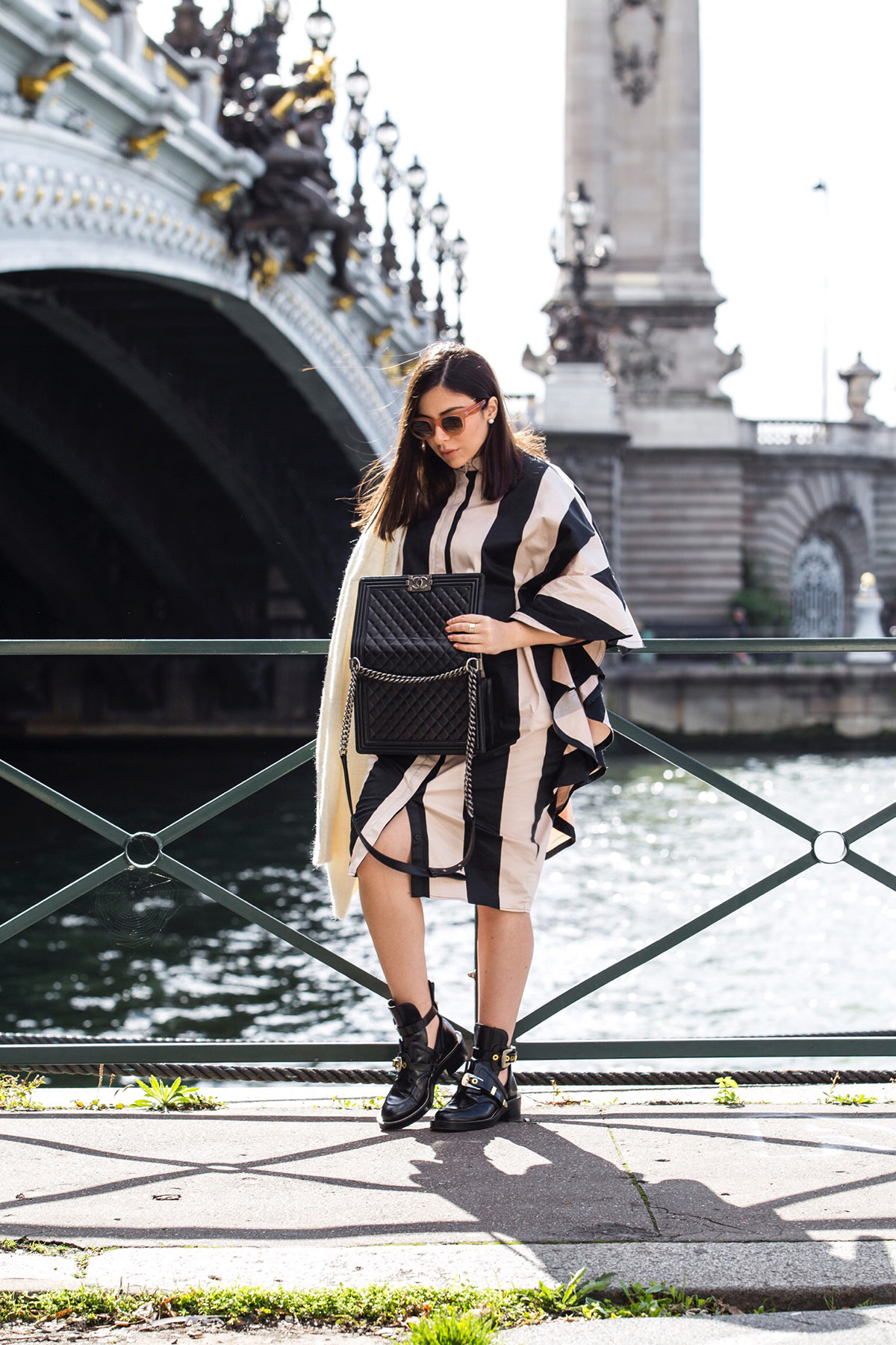 Stella Asteria wearing stripes and ruffles during Paris Fashion Week, with Chanel boy bag and Balenciaga combat boots - Paris Street Style Inspiration