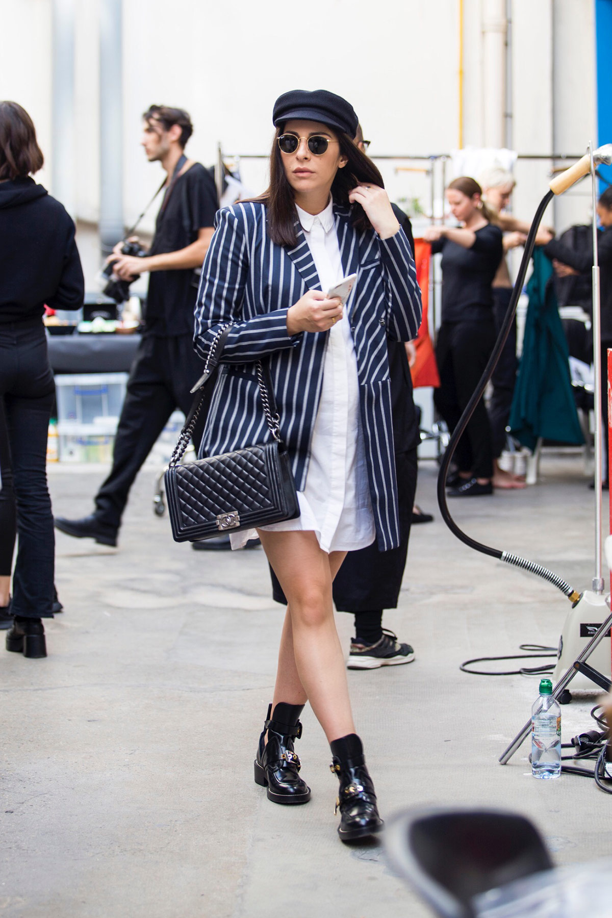 Stella Asteria at Paris Fashion Week wearing deconstructed blazer and baker boy hat