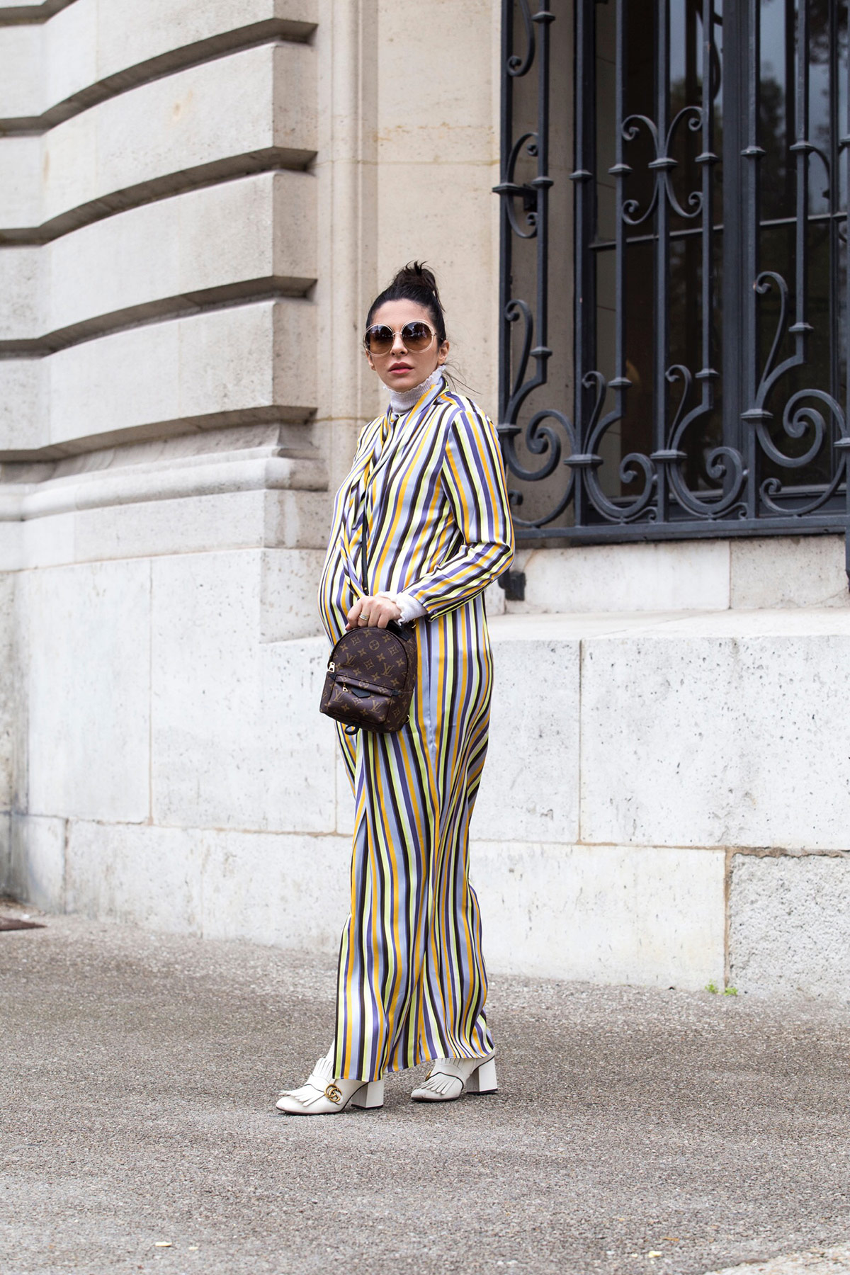 striped Acne dress worn with jeans, Gucci boots and Louis Vuitton Palm Springs backpack by Stella Asteria during Paris Fashion Week SS'18 - Paris Streetstyle and Street Fashion