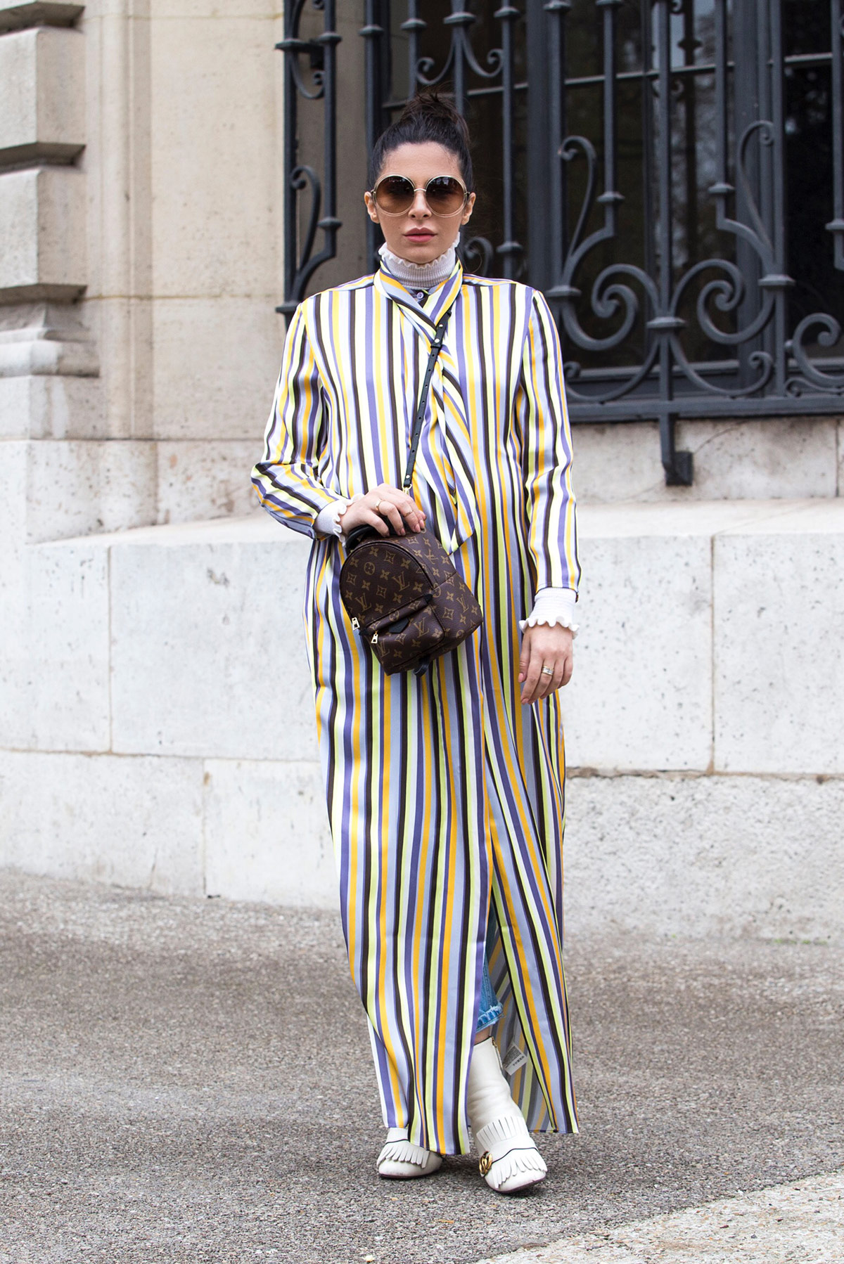 Stella Asteria wearing striped dress with jeans at Paris Fashion Week SS'18
