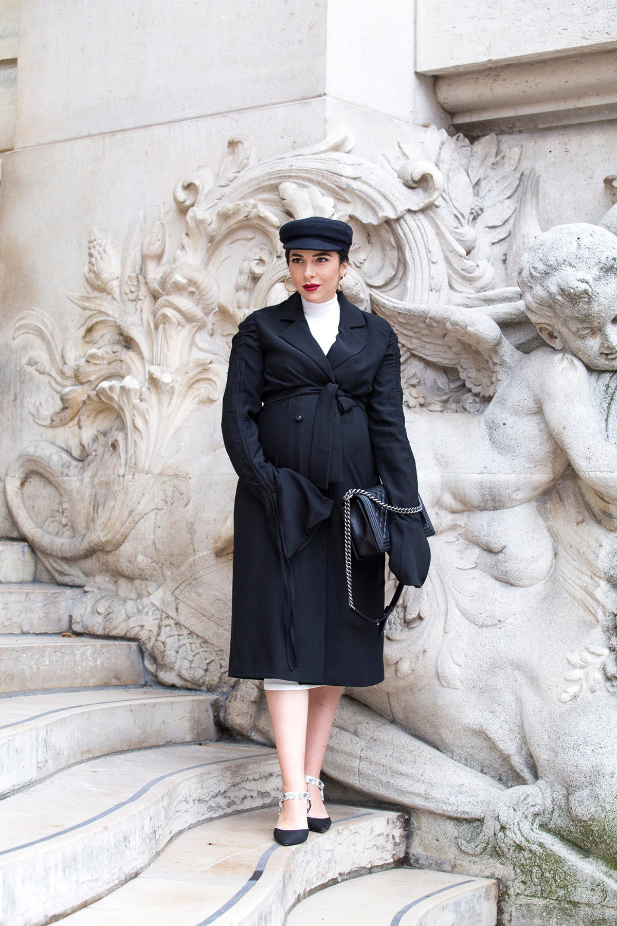 Black trench dress and baker boy hat for John Galliano Show during PFW Paris Fashion Week by Stella Asteria - Fashion & Lifestyle Blogger - Paris Fashion Week Street Style