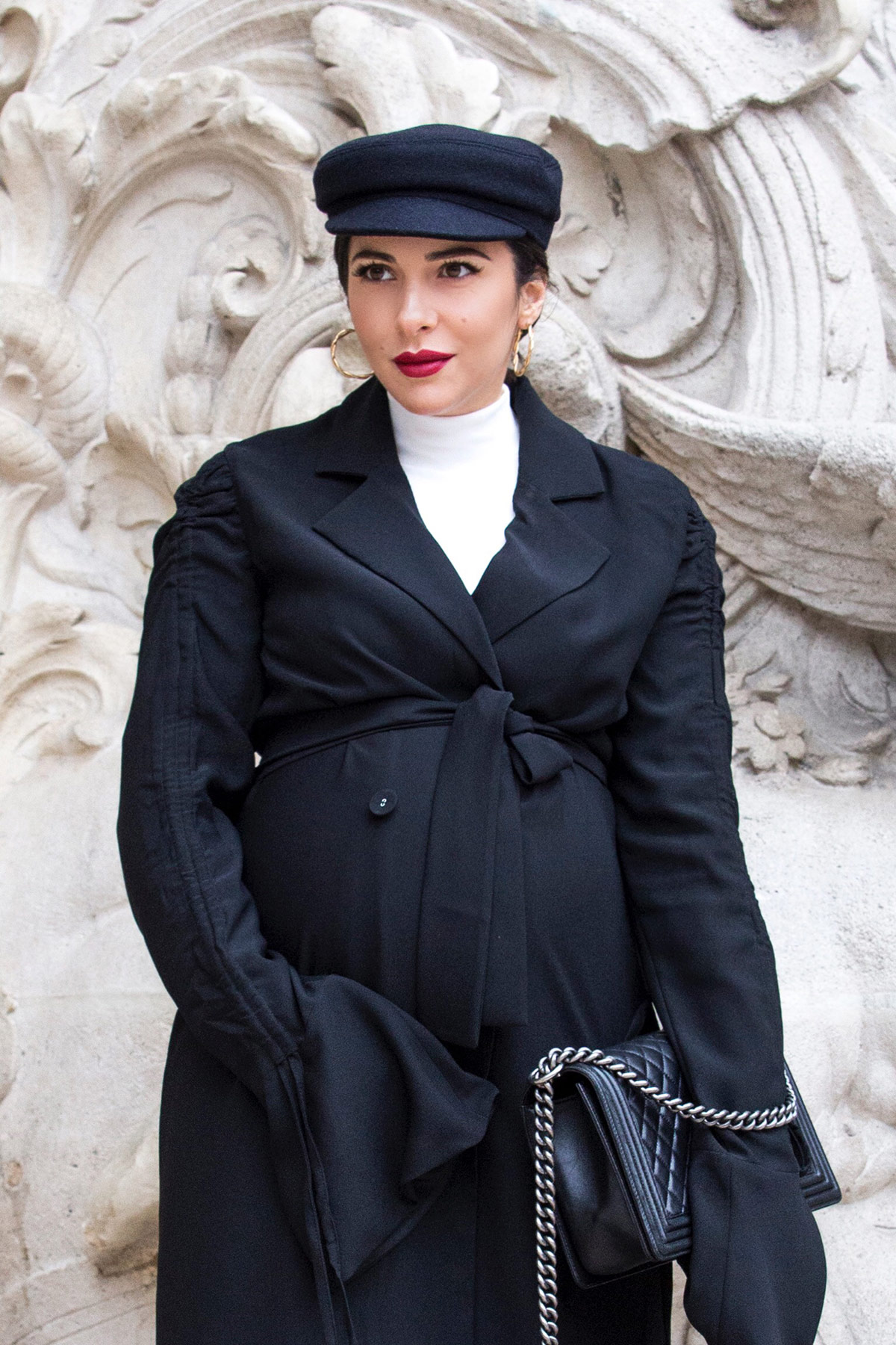 Black trench dress and baker boy hat for John Galliano Show during PFW Paris Fashion Week by Stella Asteria - Fashion & Lifestyle Blogger - Paris Fashion Week Street Style - Chanel boy bag, trench dress and total black look