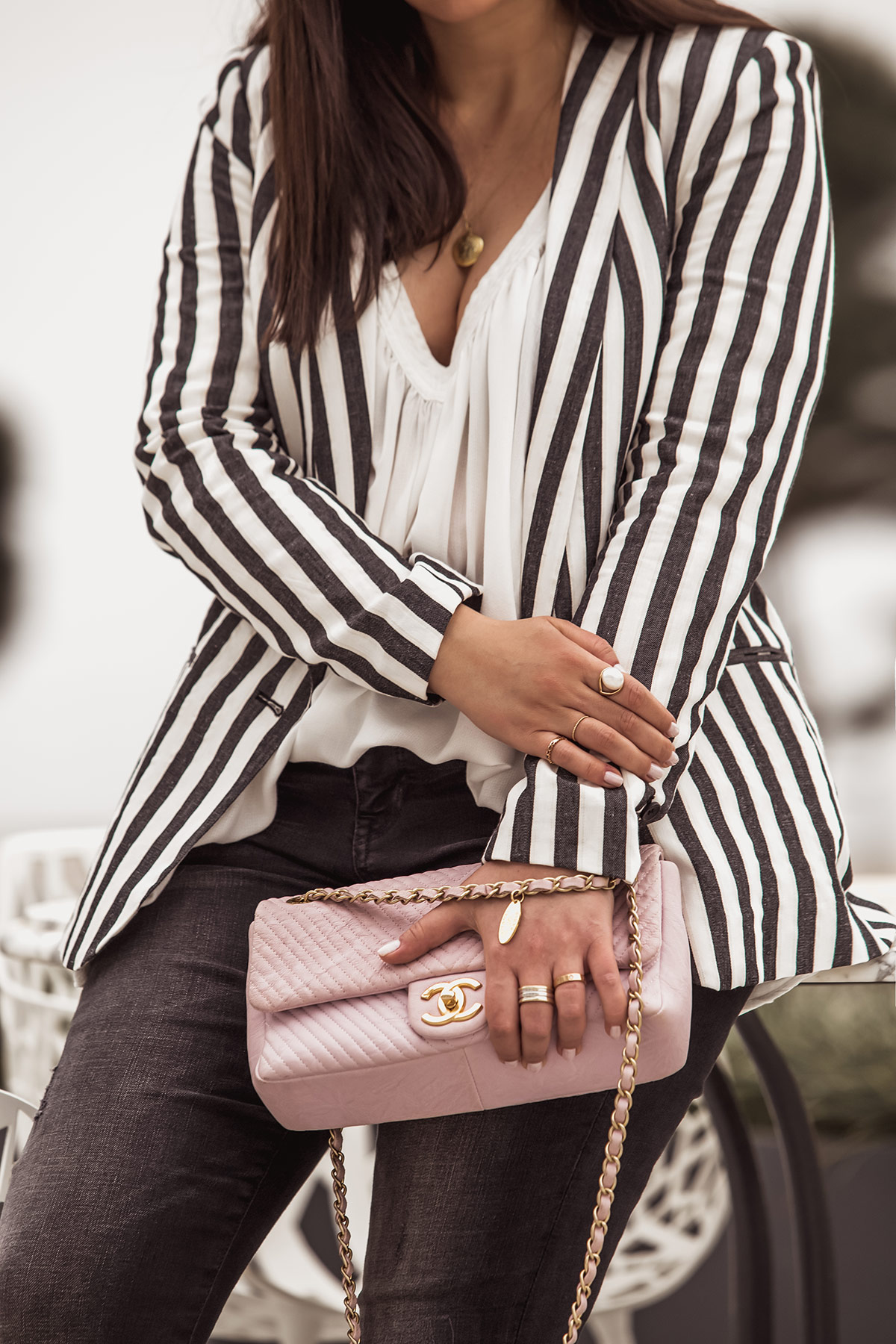 Outfit Details by Stella Asteria - striped blazer for spring, worn with Chanel chevron in pink color, white top, golden jewellery and pearl ring