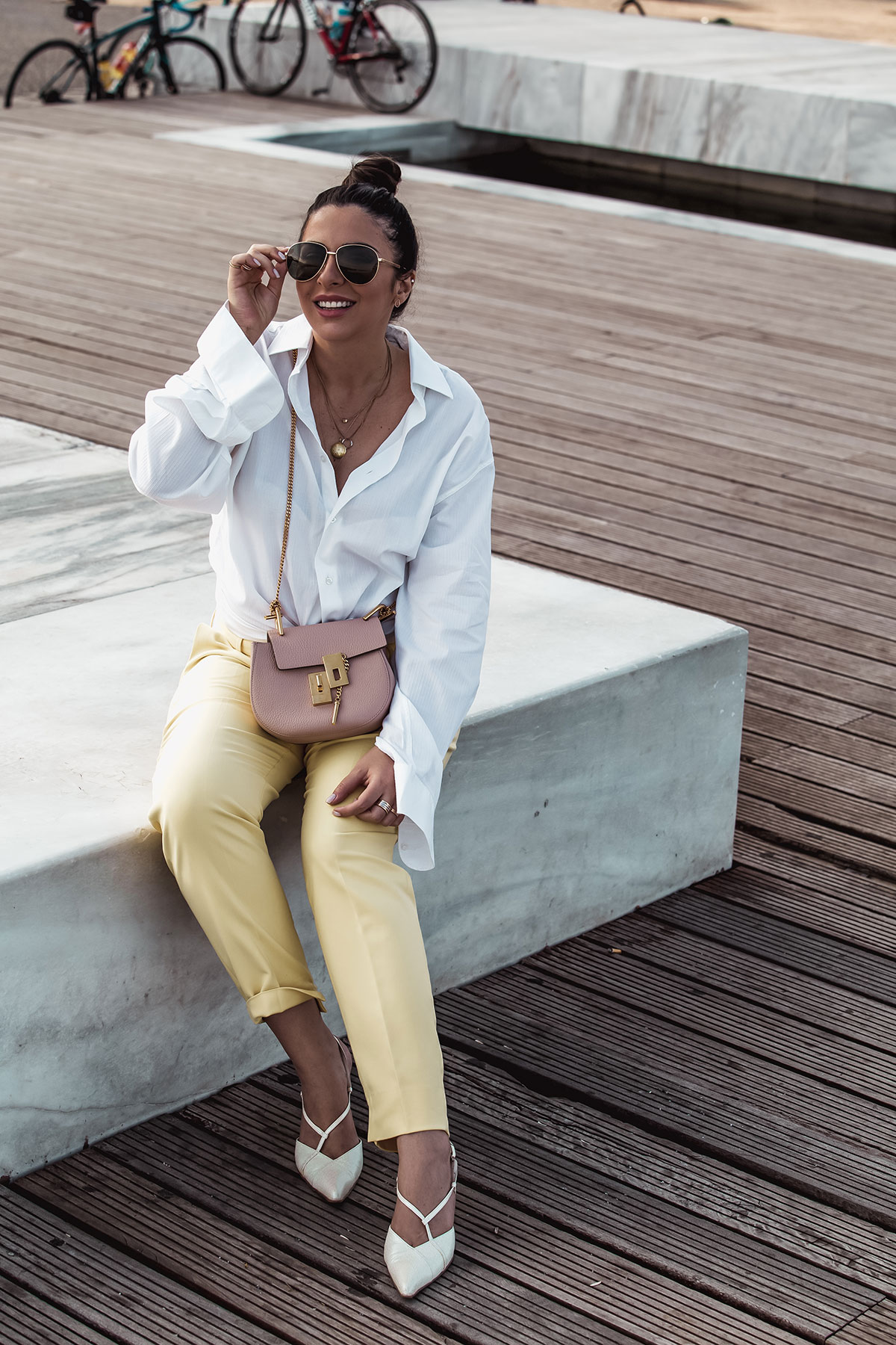nursing outfit idea - Stella Asteria wearing men's shirt, yellow pants, Chloé Drew in cement pink and Gucci men's sunglasses