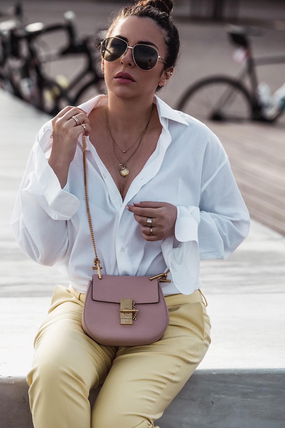 nursing nursing outfit idea - Stella Asteria wearing men's shirt, yellow pants, Chloé Drew in cement pink idea - Stella Asteria wearing men's shirt, yellow pants, Chloé Drew in cement pink and Gucci men's sunglasses