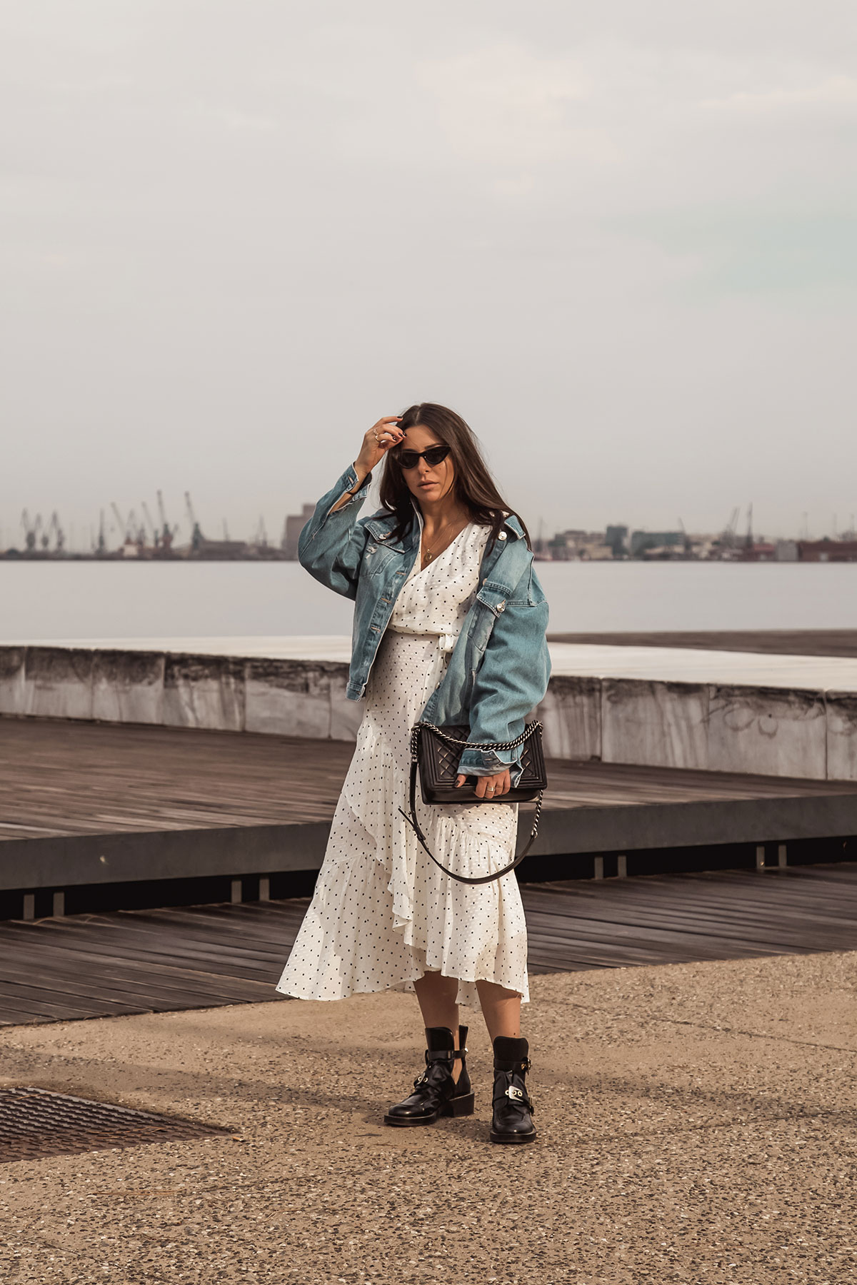 polka dot dress with edgy boots and denim jacket by Stella Asteria - Fashion & Lifestyle Blogger