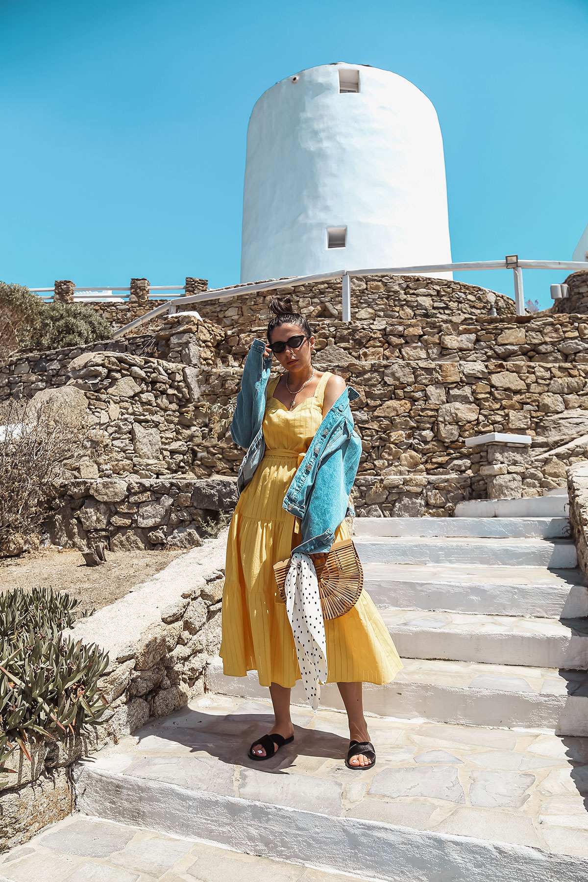 yellow dress and denim jacket in Mykonos - Michael Kors Dress worn by Stella Asteria - Fashion & Lifestyle Blogger