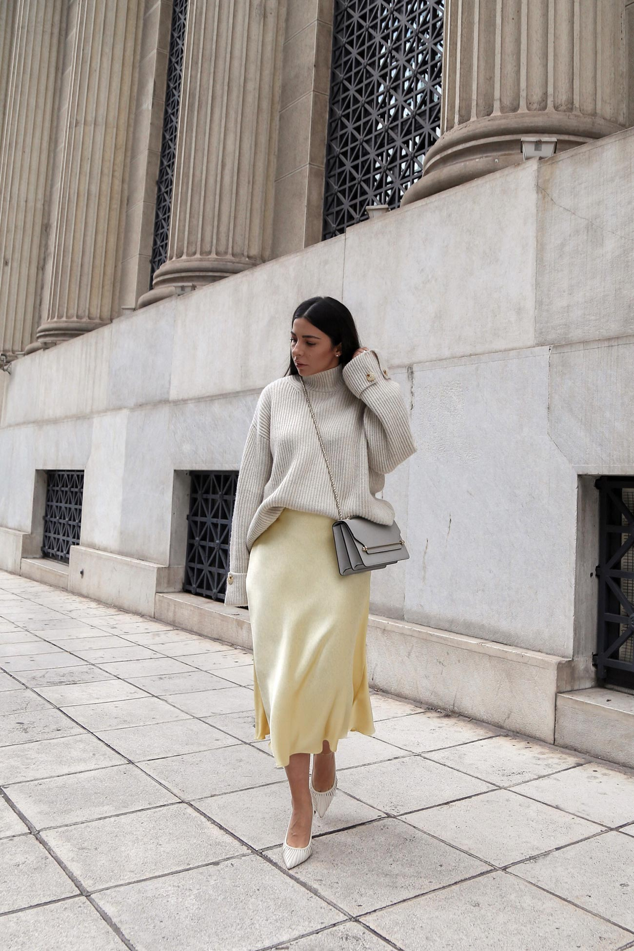yellow satin midi skirt and sweater worn with pumps and Strathberry bag by Stella Asteria