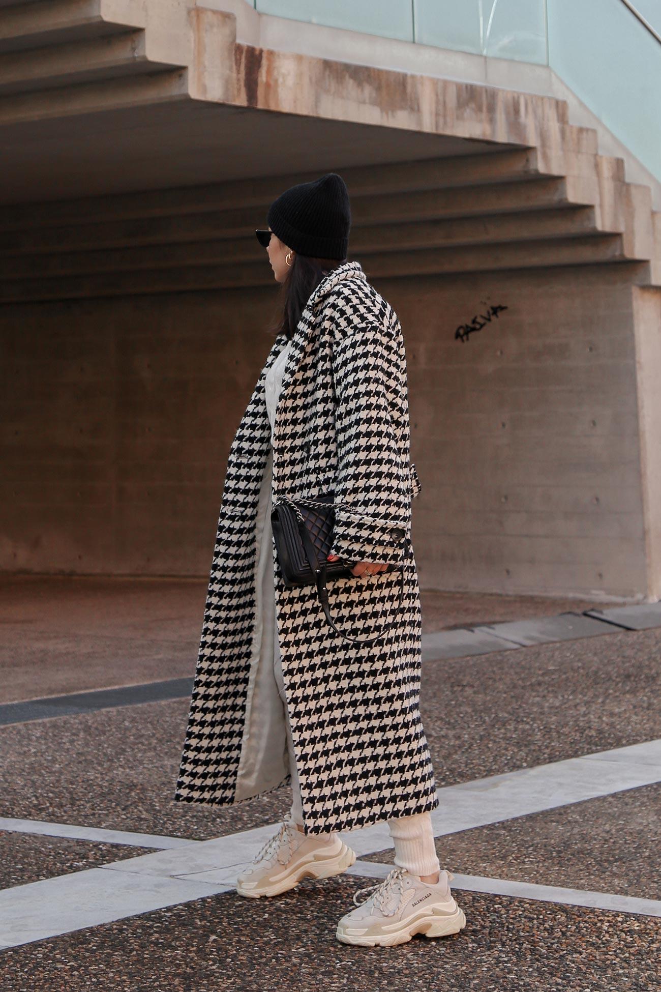 Stella Asteria street style - long coat and Balenciaga Triple S sneakers