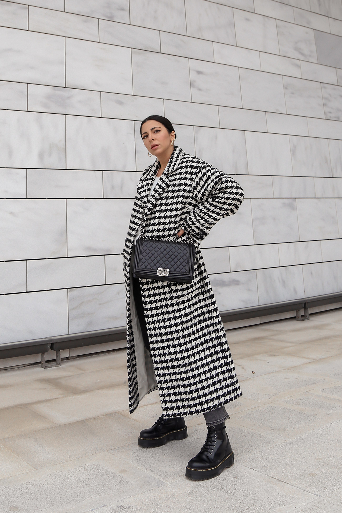 Stella Asteria wearing long black and white houndstooth coat