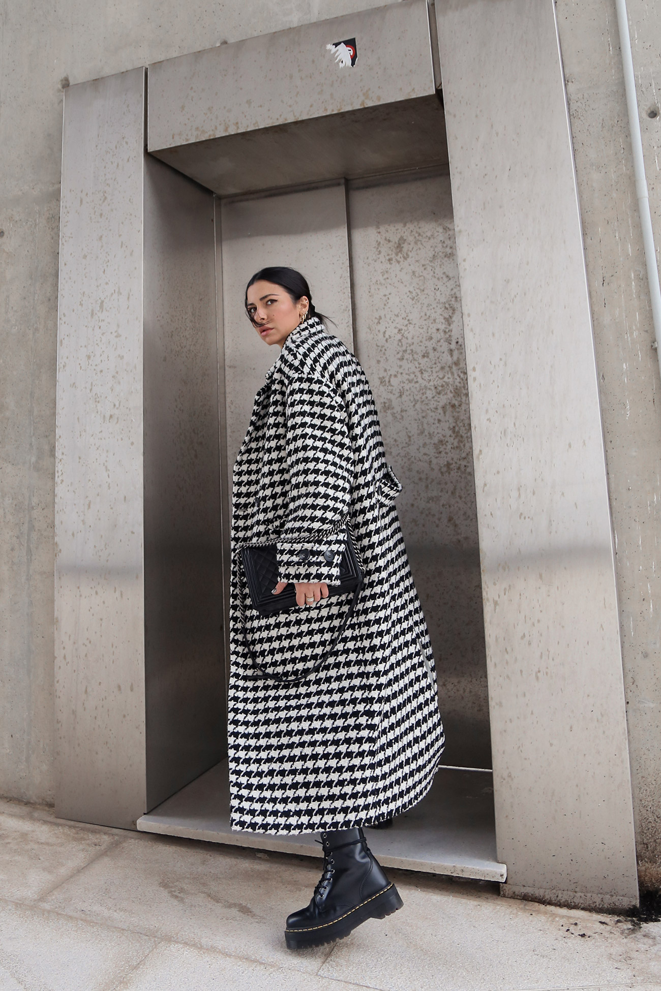 Longline coat worn with Dr Martens Jason boots and Chanel boy bag by fashion and style blogger Stella Asteria