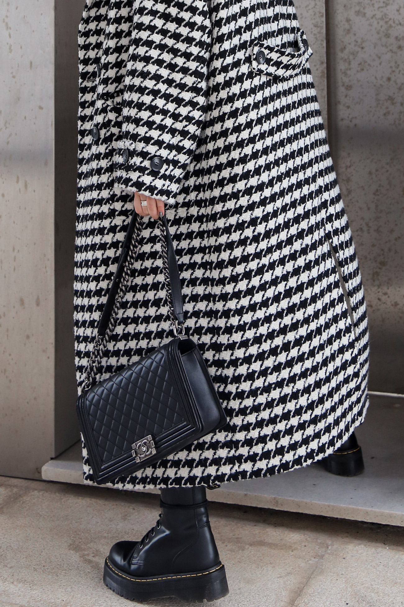 Outfit details with houndstooth coat Dr Martens boots and Chanel Boy Bag