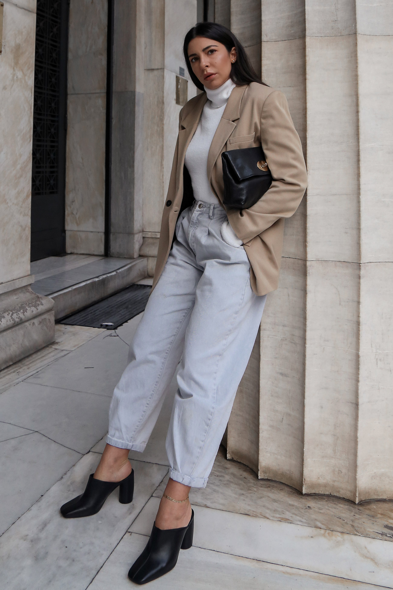 Stella Asteria wearing camel blazer with slouch jeans and mules