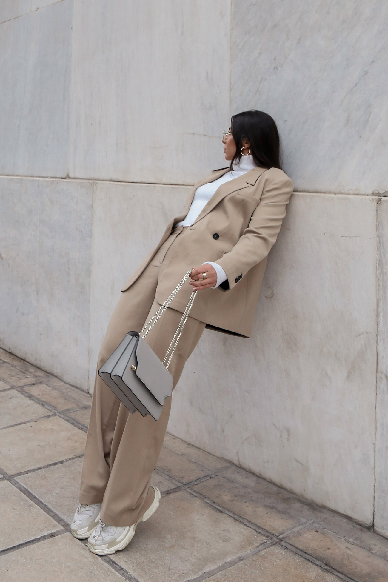 How To Wear A Women's Suit Casually - Stella Asteria dressing down a beige suit
