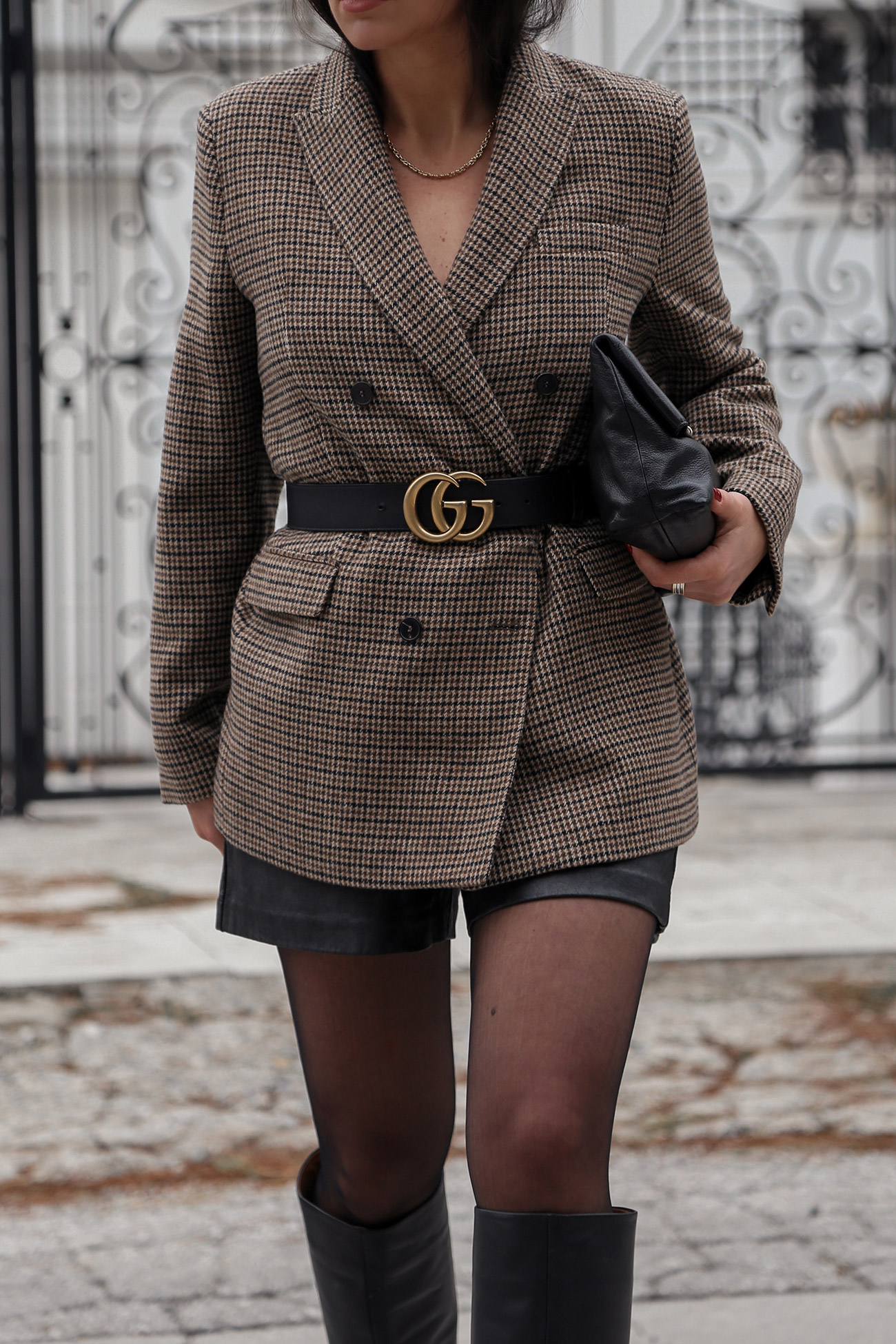 plaid blazer worn with Gucci monogram belt and shorts