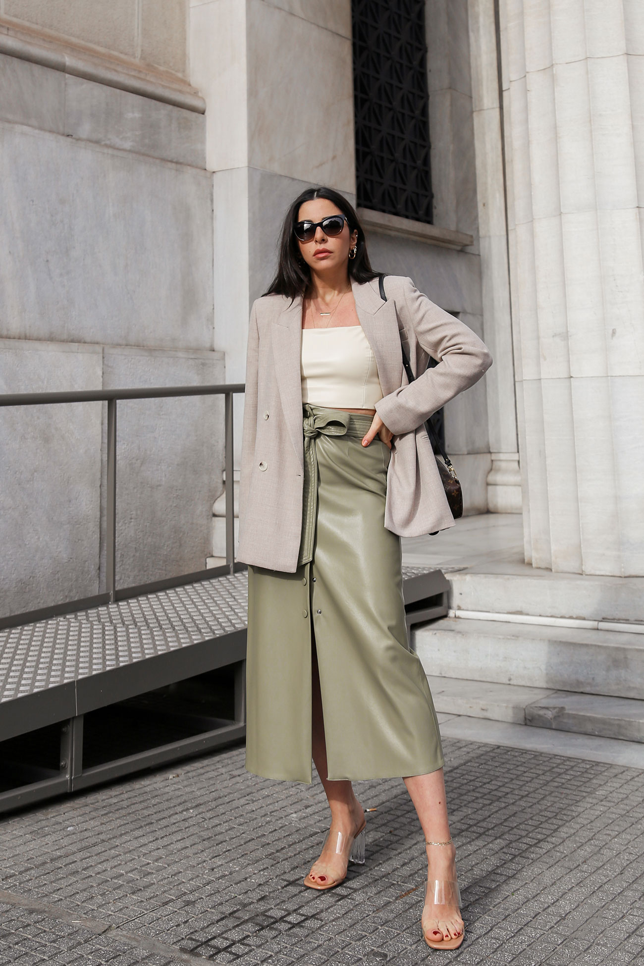 Green faux-leather skirt with light brown blazer and faux leather beige top worn by Stella Asteria
