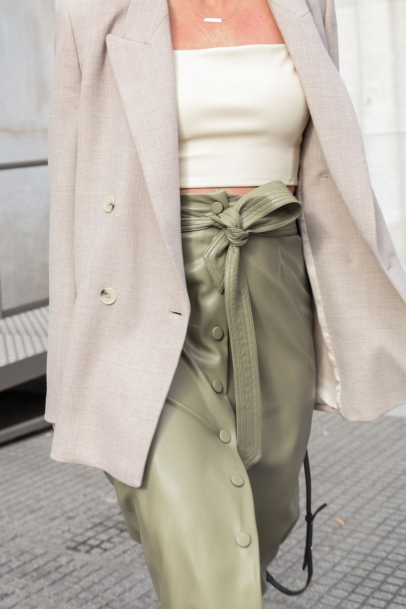 Outfit details by Stella ASteria - green leather skirt, light brown blazer and beige crop top