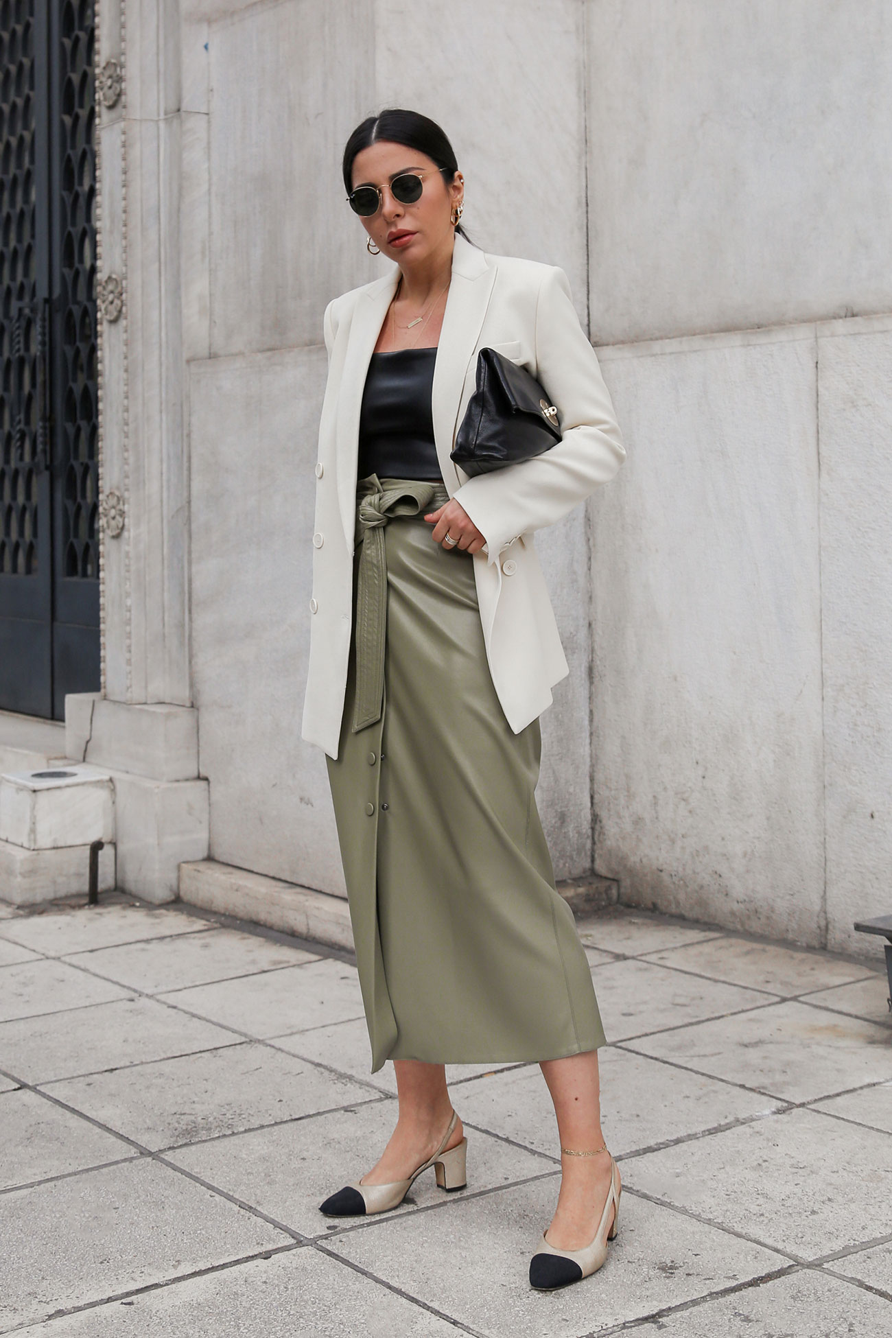 How to style a faux leather skirt - Stella Asteria wearing this season's must-have skirt with black crop top, pff-white blazer, Mulberry Clemmie clutch bag and Chanel classic slingbacks